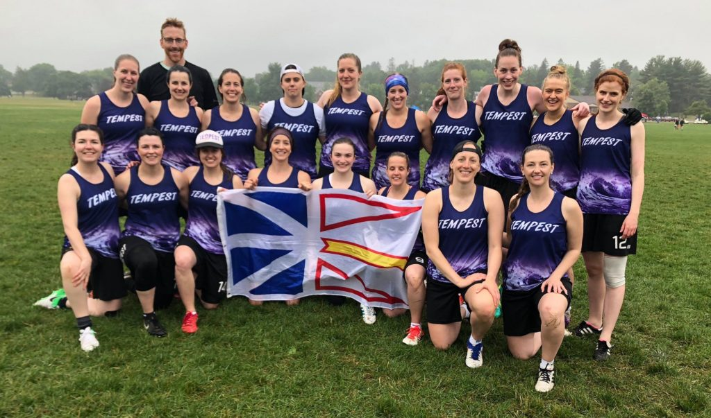 Tempest team members hold the provincial flag of Newfoundland and Labrador during the 2018 Boston Invite.