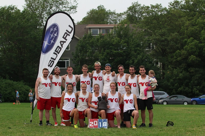 Young Guns poses with the Flaherty Cup after winning the 2018 summer league title from Mile Zero Ultimate.