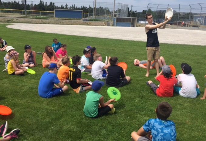 Will Kerr leads a youth ultimate clinic in Bay Roberts this summer.