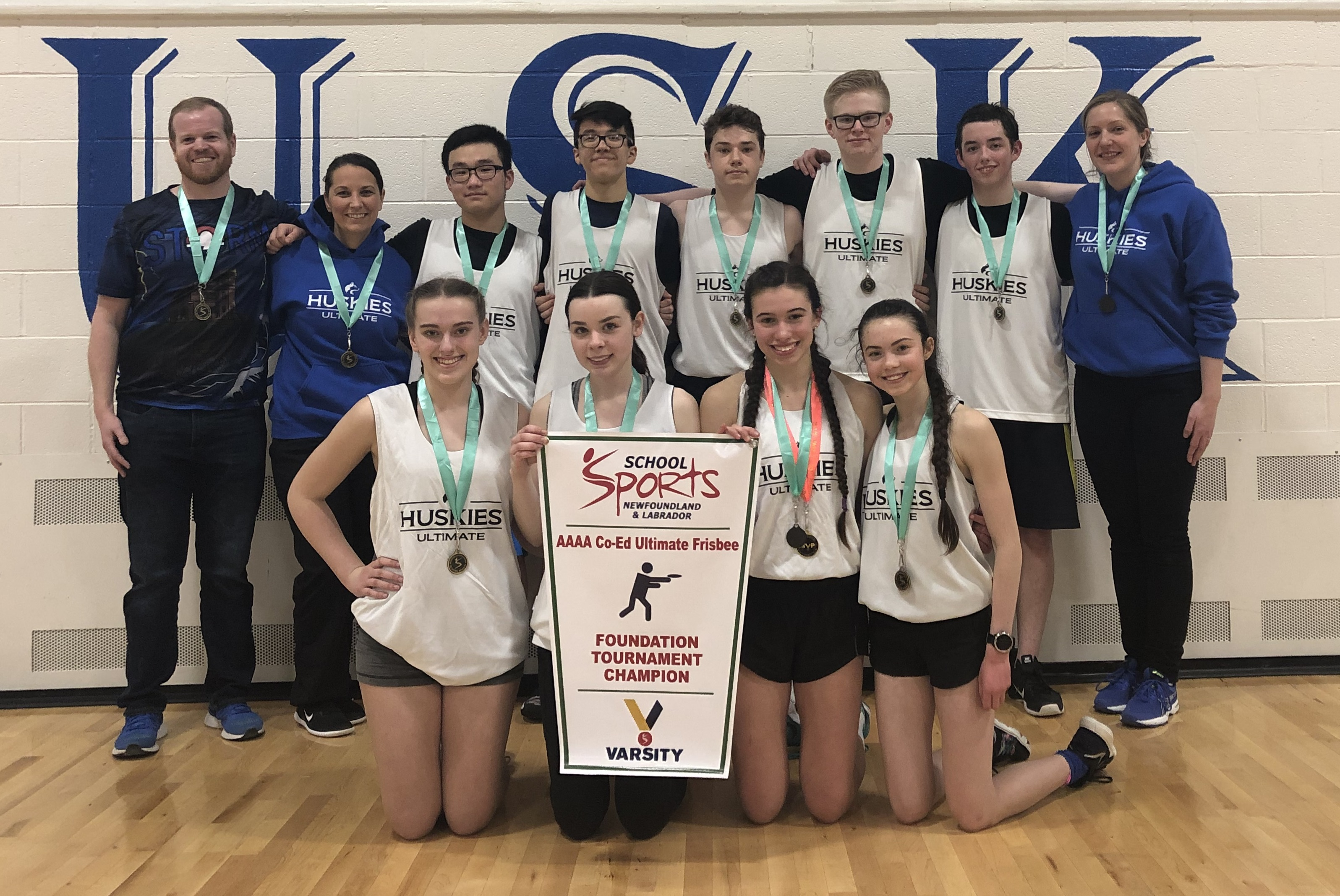 Mount Pearl Senior High, pictured with coaches Aaron Power, Natalie O'Donnell and Claire Moore-Gibbons, won the first banner for ultimate frisbee from School Sports NL.