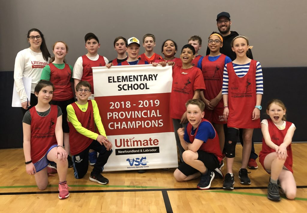 The elementary school team from École des Grands-Vents poses with the provincial banner from Ultimate Newfoundland and Labrador.