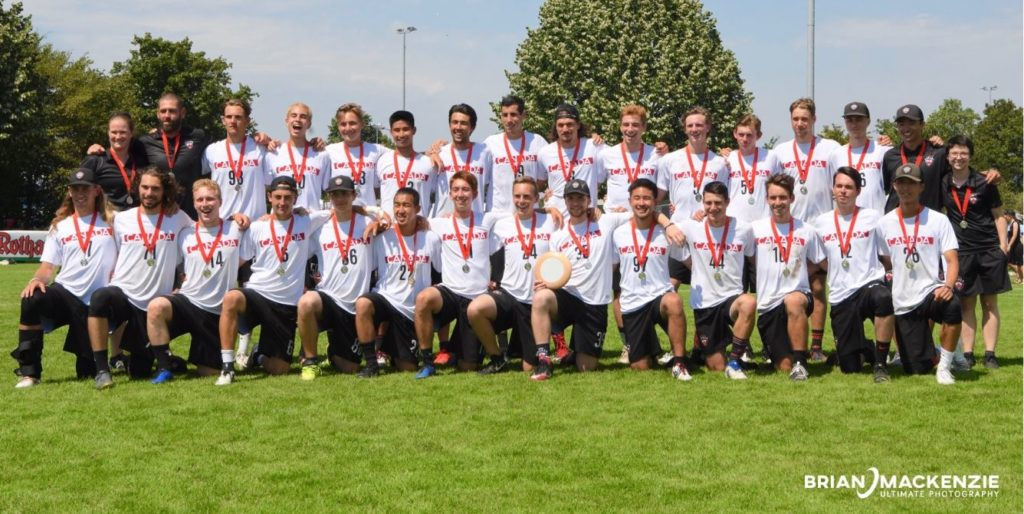 A photo of Team Canada wearing their silver medals from the WFDF U24 World Ultimate Championships.