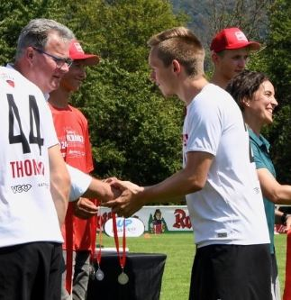 Luke Dyer is pictured receiving a silver medal at the WFDF U24 World Ultimate Championships.