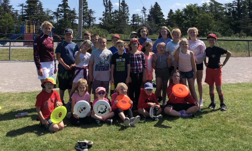 Ultimate NL's summer clinics co-ordinator, Annika Bieger, poses with youth participants in a summer clinic.