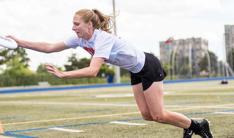 Erin Daly drags her toe to catch the disc in bounds in the Canadian Ultimate Championships' mixed division play. Photo courtesy of Ultimate Canada.