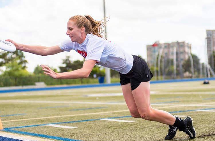 Erin Daly is pictured making a layout catch at the 2019 Canadian Ultimate Championships