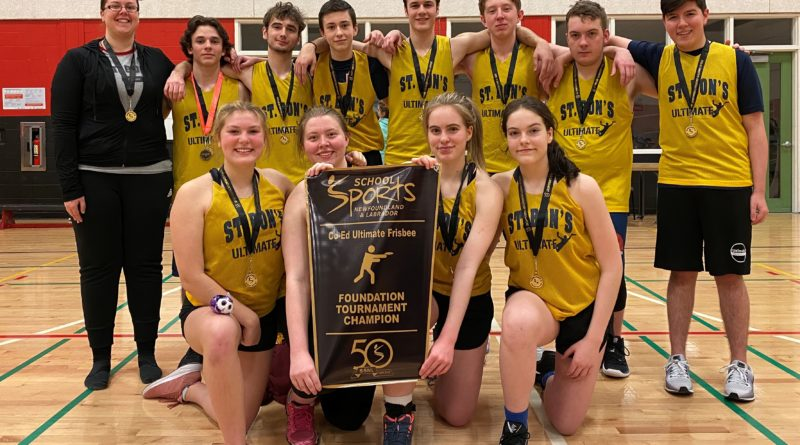 A team photo of St. Bonaventure College's ultimate frisbee team holding the championship banner from School Sports Newfoundland and Labrador.