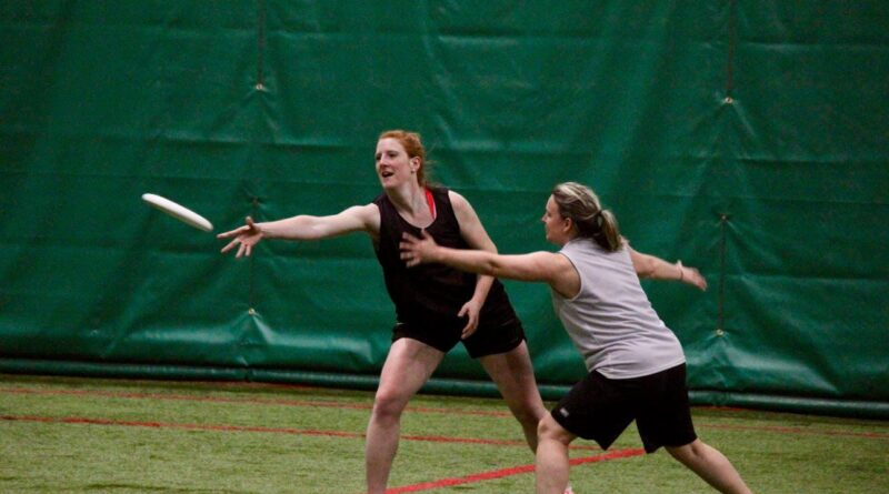 Two female-matching players face of against each other in the St. John's Women's Recreational Ultimate League (SWURL).